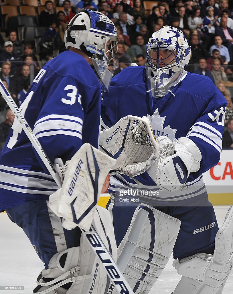 James Reimer #34 of the Toronto Maple Leafs shakes hands with teammate teammate <a gi-track='captionPersonalityLinkClicked' href=/galleries/search?phrase=Ben+Scrivens&family=editorial&specificpeople=7185205 ng-click='$event.stopPropagation()'>Ben Scrivens</a> #30 after being pulled in the third period during NHL game action against the Montreal Canadiens April 27, 2013 at the Air Canada Centre in Toronto, Ontario, Canada.
