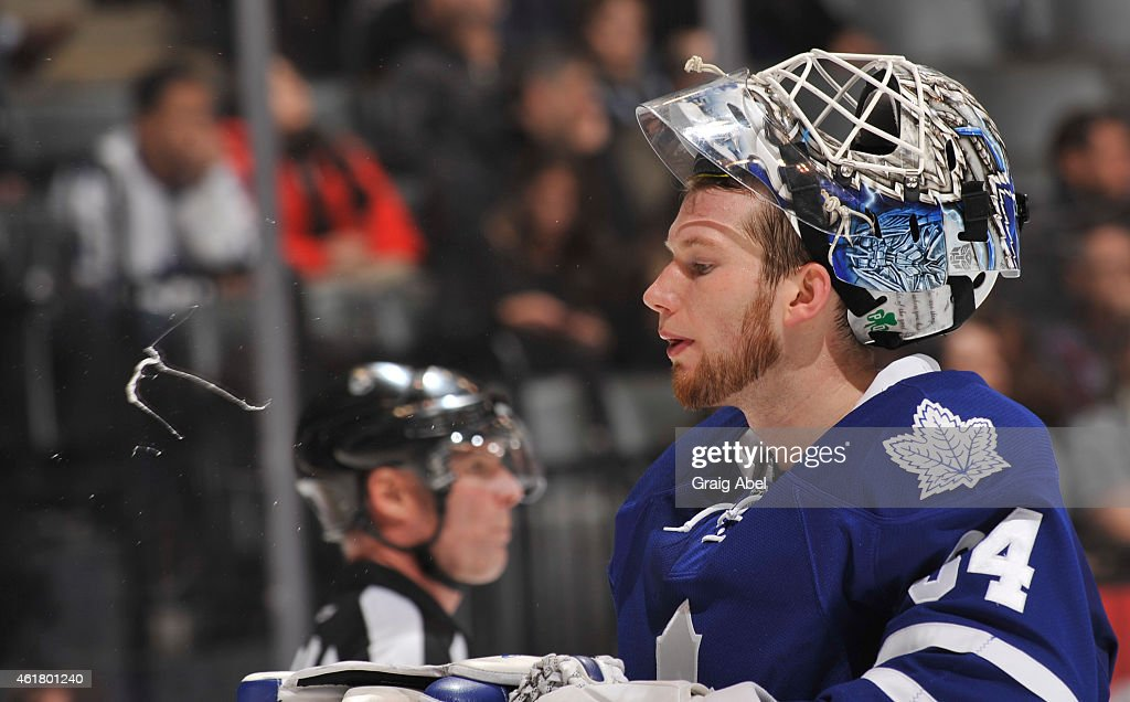 <a gi-track='captionPersonalityLinkClicked' href=/galleries/search?phrase=James+Reimer+-+Hockey+Player&family=editorial&specificpeople=7543302 ng-click='$event.stopPropagation()'>James Reimer</a> #34 of the Toronto Maple Leafs spits during a break in NHL game action against the Carolina Hurricanes January 19, 2015 at the Air Canada Centre in Toronto, Ontario, Canada.
