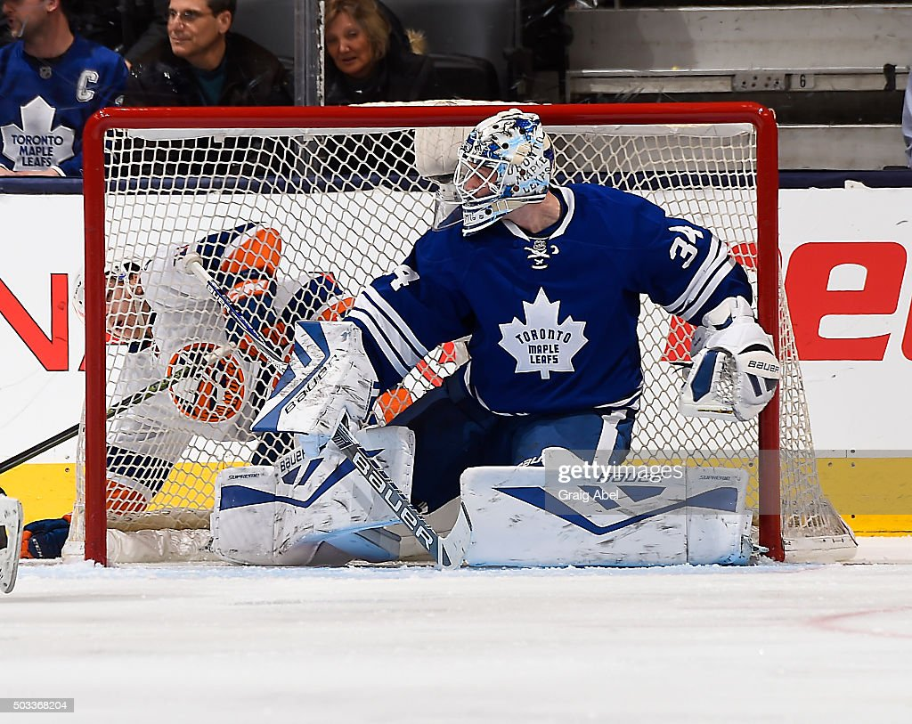 <a gi-track='captionPersonalityLinkClicked' href=/galleries/search?phrase=James+Reimer+-+Hockey+Player&family=editorial&specificpeople=7543302 ng-click='$event.stopPropagation()'>James Reimer</a> #34 of the Toronto Maple Leafs stops a shot against the New York Islanders during game action on December 29, 2015 at Air Canada Centre in Toronto, Ontario, Canada.