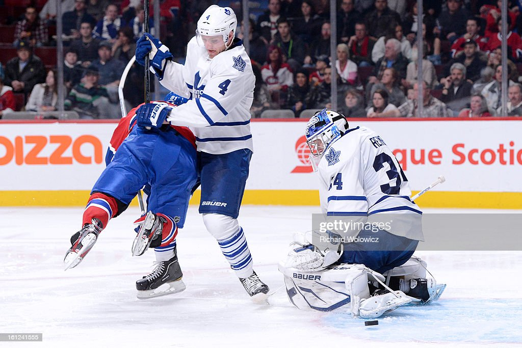 James Reimer #34 of the Toronto Maple Leafs stops the puck in front of teammate <a gi-track='captionPersonalityLinkClicked' href=/galleries/search?phrase=Cody+Franson&family=editorial&specificpeople=2125769 ng-click='$event.stopPropagation()'>Cody Franson</a> #4 and <a gi-track='captionPersonalityLinkClicked' href=/galleries/search?phrase=Lars+Eller&family=editorial&specificpeople=4324947 ng-click='$event.stopPropagation()'>Lars Eller</a> #81 of the Montreal Canadiens during the NHL game at the Bell Centre on February 9, 2013 in Montreal, Quebec, Canada. The Maple Leafs defeated the Canadiens 6-0.
