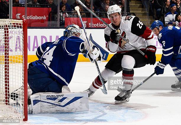 James Reimer of the Toronto Maple Leafs stops the shot by Michael Stone of the Arizona Coyotes during game action on October 26 2015 at Air Canada...