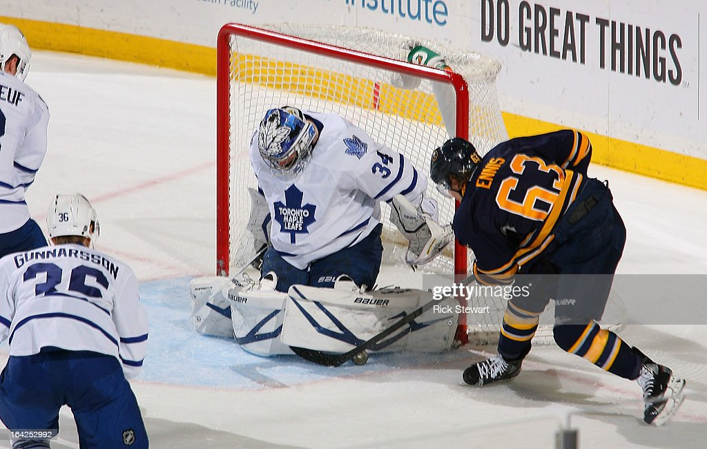 James Reimer #34 of the Toronto Maple Leafs stops <a gi-track='captionPersonalityLinkClicked' href=/galleries/search?phrase=Tyler+Ennis+-+Ice+Hockey+Player&family=editorial&specificpeople=4754184 ng-click='$event.stopPropagation()'>Tyler Ennis</a> #63 of the Buffalo Sabres at First Niagara Center on March 21, 2013 in Buffalo, United States.Buffalo won 5-4 in a shootout.