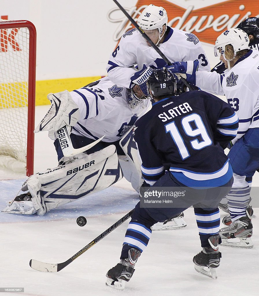 James Reimer #34 of the Toronto Maple Leafs tries to keep his eye on the puck in front of his goal in a game against the Winnipeg Jets during third period action on March 12, 2013 at the MTS Centre in Winnipeg, Manitoba, Canada.
