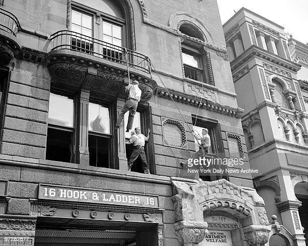 James Rice and John Dougal fly throught the air with equal daring as they demonstrate their original technic for plucking wouldbe suicides off high...