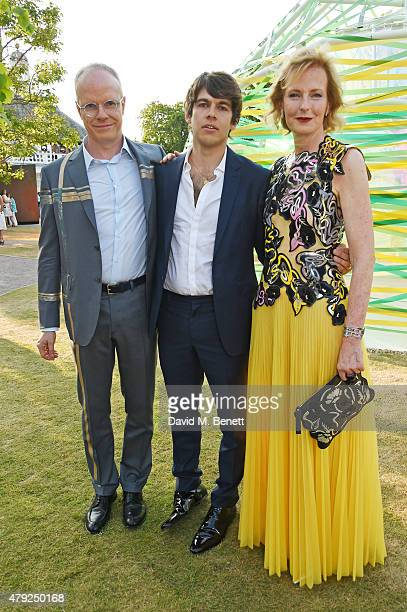 James Righton poses with CoDirectors of the Serpentine Gallery HansUlrich Obrist and Julia PeytonJones at The Serpentine Gallery summer party at The...