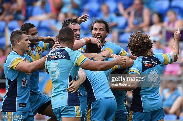 James Roberts celebrates scoring a try with team mates during the round seven NRL match between the Gold Coast Titans and the Penrith Panthers at...
