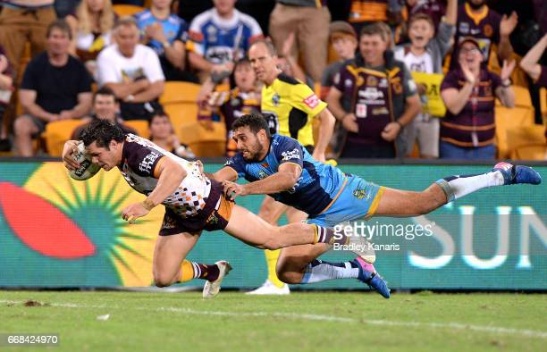 James Roberts of the Broncos dives over the tryline to score the match winning try during the round seven NRL match between the Brisbane Broncos and...
