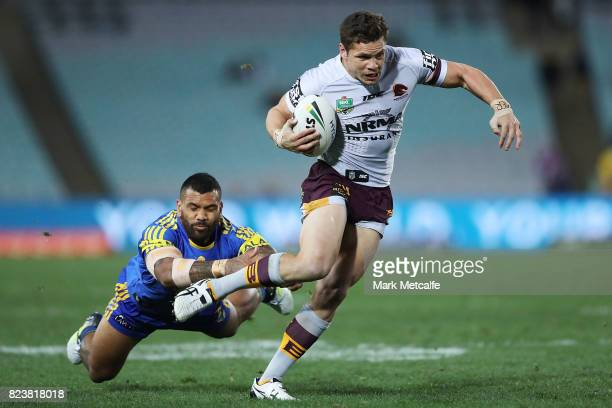 James Roberts of the Broncos evades a tackle during the round 21 NRL match between the Parramatta Eels and the Brisbane Broncos at ANZ Stadium on...