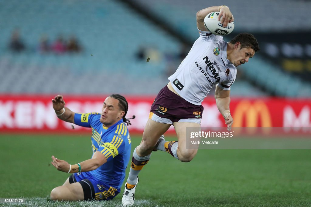 James Roberts of the Broncos evades the tackle of Brad Takairangi of the Eels during the round 21 NRL match between the Parramatta Eels and the Brisbane Broncos at ANZ Stadium on July 28, 2017 in Sydney, Australia.