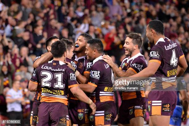 James Roberts of the Broncos is congratulated by team mates after scoring a try during the round 20 NRL match between the Brisbane Broncos and the...