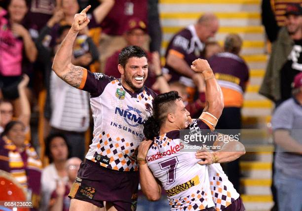 James Roberts of the Broncos is congratulated by team mates after scoring the match winning try during the round seven NRL match between the Brisbane...