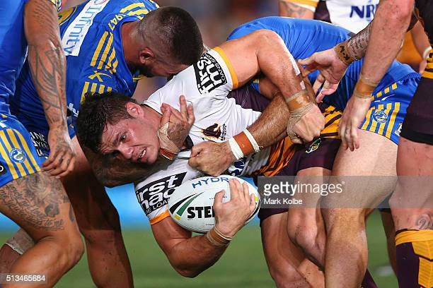 James Roberts of the Broncos is tackled during the round one NRL match between the Parramatta Eels and the Brisbane Broncos at Pirtek Stadium on...