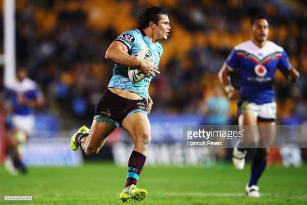 James Roberts of the Broncos makes a break to score a try during the round 12 NRL match between the New Zealand Warriors and the Brisbane Broncos at...