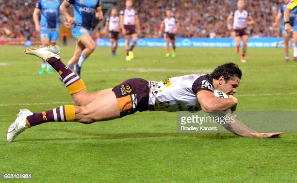 James Roberts of the Broncos scores a try during the round seven NRL match between the Brisbane Broncos and the Gold Coast Titans at Suncorp Stadium...