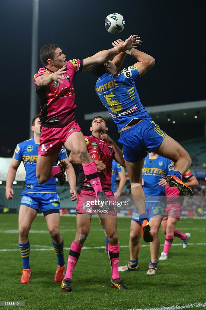 James Roberts of the Panthers and Brayden Wiliame of the Eels compete for the ball from a kick during the round 18 NRL match between Parramatta Eels and the Penrith Panthers at Parramatta Stadium on July 13, 2013 in Sydney, Australia.