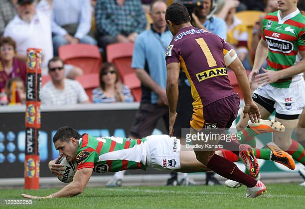 James Roberts of the Rabbitohs scores a try during the round 25 NRL match between the Brisbane Broncos and the South Sydney Rabbitohs at Suncorp...