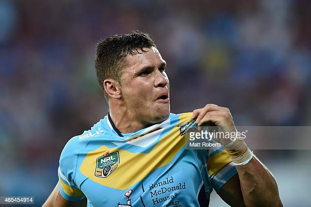 James Roberts of the Titans celebrates scoring a try during the round one NRL match between the Gold Coast Titans and the Wests Tigers at Cbus Super...