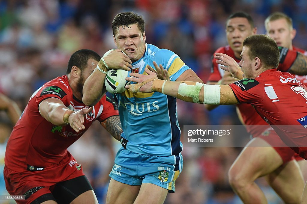 James Roberts of the Titans is tackled during the round 25 NRL match between the Gold Coast Titans and the St George Illawarra Dragons at Cbus Super...
