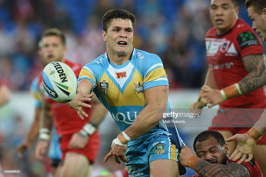 James Roberts of the Titans passes the ball during the round 25 NRL match between the Gold Coast Titans and the St George Illawarra Dragons at Cbus Super Stadium on August 30, 2015 on the Gold Coast, Australia.