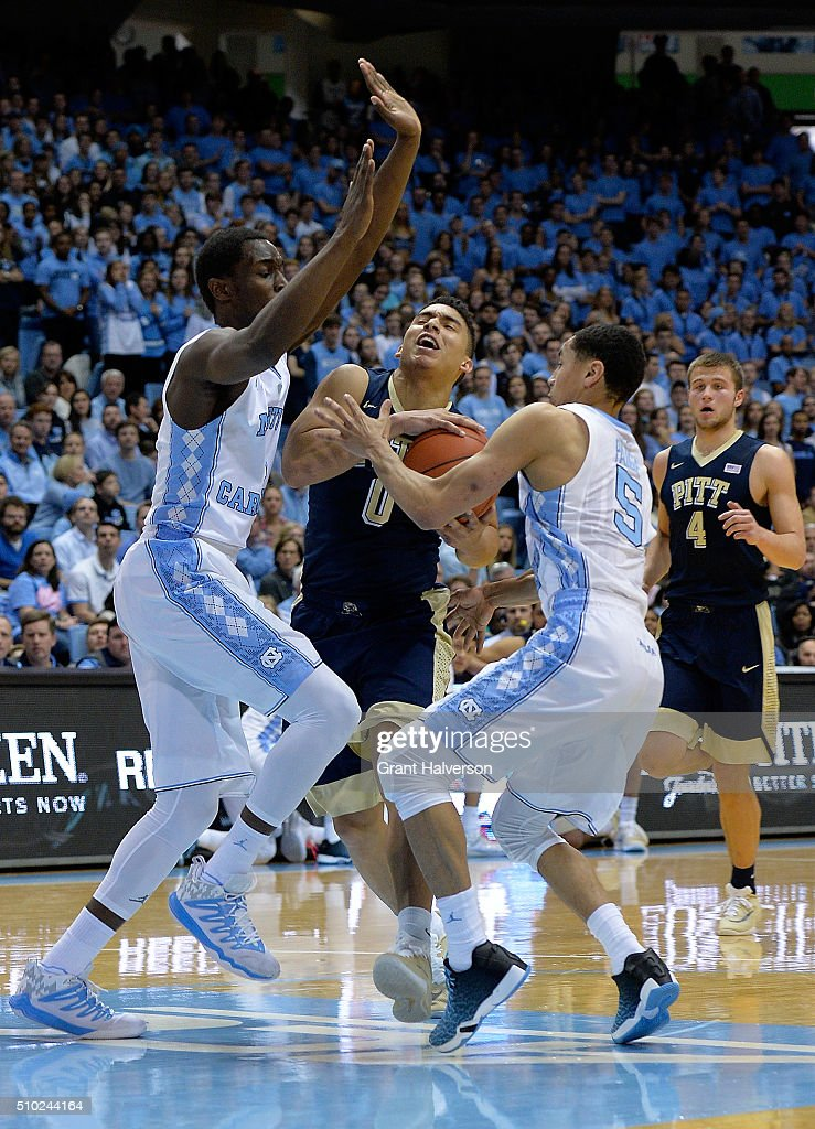 James Robinson #0 of the Pittsburgh Panthers drives between Theo Pinson #1 and Marcus Paige #5 of the North Carolina Tar Heels during their game at the Dean Smith Center on February 14, 2016 in Chapel Hill, North Carolina.