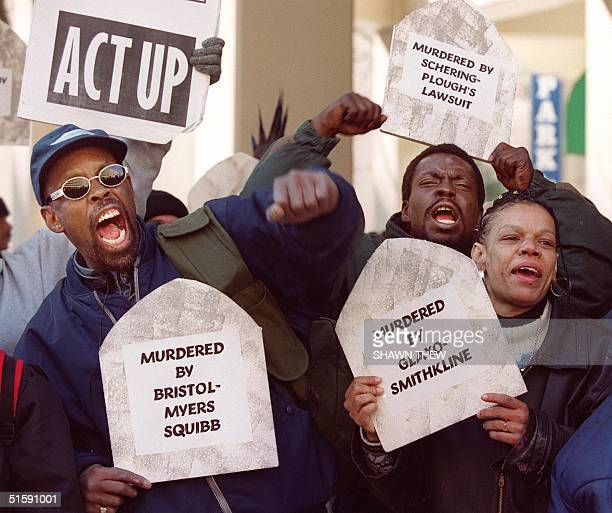 James Robinson Tyrone Cooper and Lavenin Baylor march with other protesters in front of the Pharmaceutical Research and Manufacturers of America...