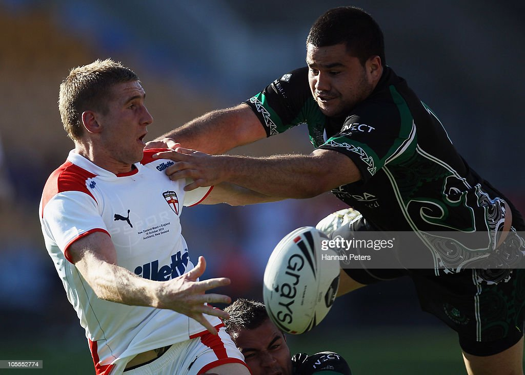 James Roby of England passes the ball back past Justin Horo of New Zealand Maori during the international match between New Zealand Maori and England at Mt Smart Stadium on October 16, 2010 in Auckland, New Zealand.