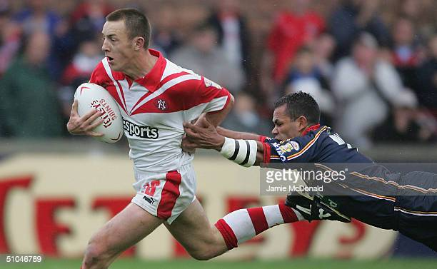 James Roby of Saints beats the tackle of Denis Moran of London Broncos to score a try during the Tetleys Super League match between St Helens Saints...