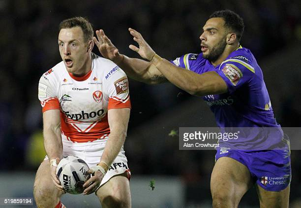 James Roby of St Helens and Ryan Atkins of Warrington during the First Utility Super League match between Warrington Wolves and St Helens at...