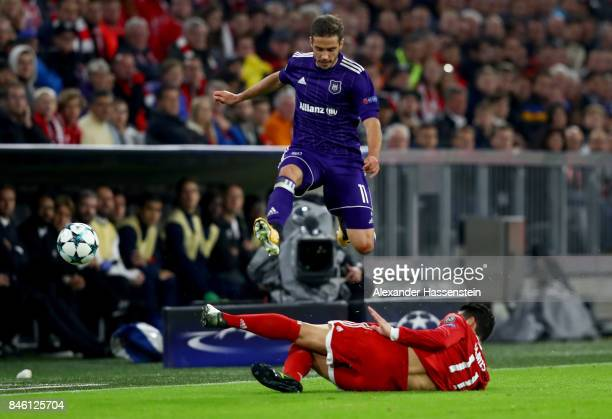 James Rodríguez of Muenchen and Alexandru Chipciu of Anderlecht battle for the ball during the UEFA Champions League group B match between Bayern...