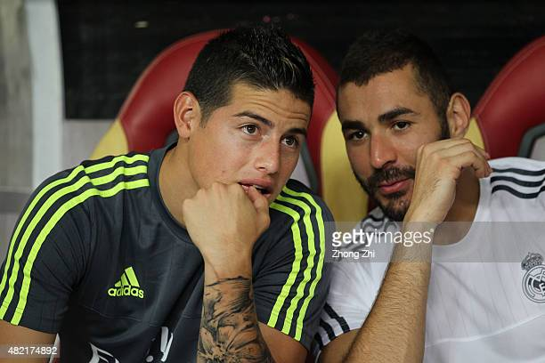 James Rodriguez and Benzema of Real Madrid talk on the bench during the match of International Champions Cup China 2015 between Real Madrid and FC...