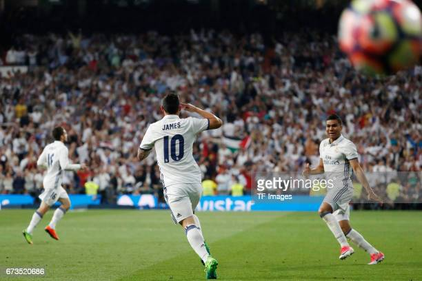 James Rodriguez and Casemiro of Real Madrid celebrate a goal during the La Liga match between Real Madrid CF and FC Barcelona at the Santiago...
