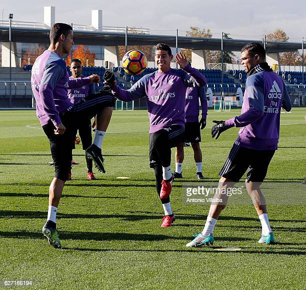 James Rodriguez and Cristiano Ronaldo of Real Madrid during a training session at Valdebebas training ground on December 2 2016 in Madrid Spain
