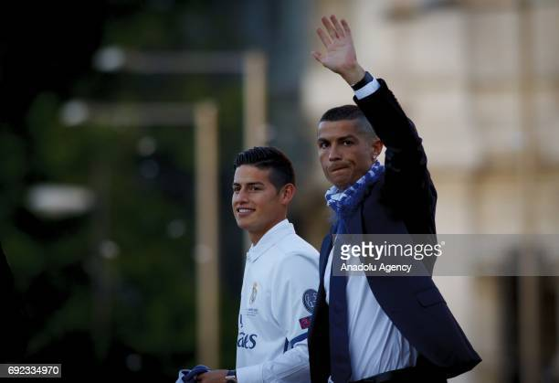 James Rodriguez and Cristiano Ronaldo of Real Madrid gesture during celebrations at Cibeles Fountain after winning the 2016/17 UEFA Champions League...