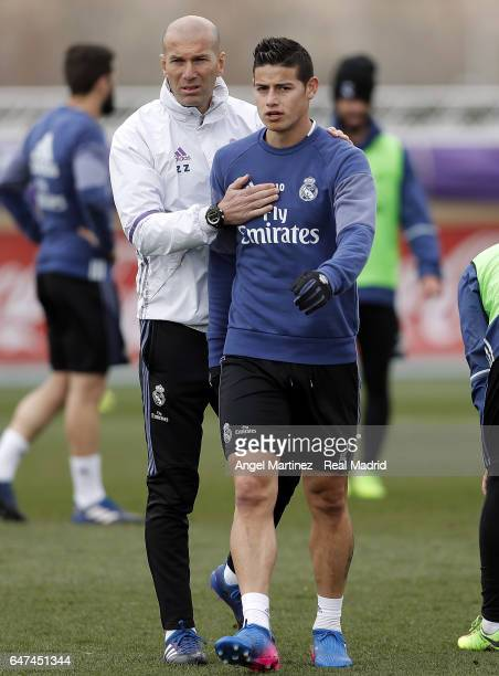 James Rodriguez and head coach Zinedine Zidane of Real Madrid during a training session at Valdebebas training ground on March 3 2017 in Madrid Spain