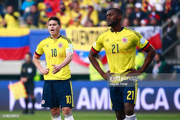James Rodriguez and Jackson Martinez of Colombia look dejected after the 2015 Copa America Chile Group C match between Colombia and Peru at Municipal...