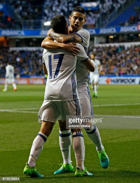 James Rodriguez and Lucas Vazquez of Real Madrid celebrates after scoring goal whit his teammates during the La Liga match between RC Deportivo La...