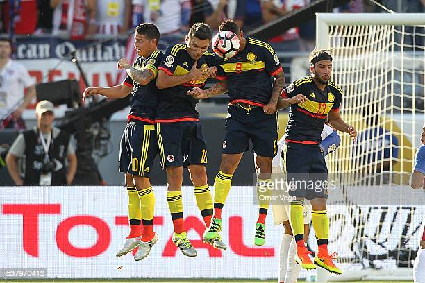 James Rodriguez Daniel Torres Edwin Cardona and Sebastian Perez of Colombia jump to block the ball during a group A match between United States and...