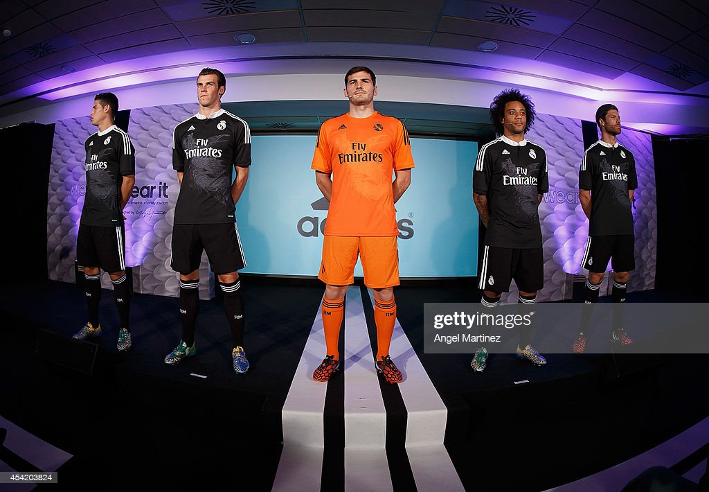 James Rodriguez, Gareth Bale, Iker Casillas, Xabi Alonso and Marcelo Vieira of Real Madrid during the Adidas 3rd kit launch at Estadio Santiago Bernabeu on August 26, 2014 in Madrid, Spain.