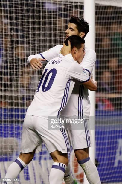 James Rodriguez midfielder of Real Madrid and Alvaro Morata forward of Real Madrid celebrate a goal during the La Liga Santander match between...