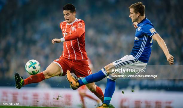 James Rodriguez of Bayern in action against Bastian Oczipka of Schalke during the Bundesliga match between FC Schalke 04 and FC Bayern Muenchen at...