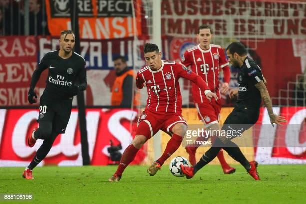 James Rodriguez of Bayern Muenchen and Dani Alves of Paris SaintGermain Layvin Kurzawa of Paris SaintGermain battle for the ball during the UEFA...