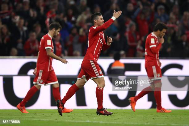 James Rodriguez of Bayern Muenchen celebrates after he scored his teams first goal to make it 10 during the Bundesliga match between FC Bayern...