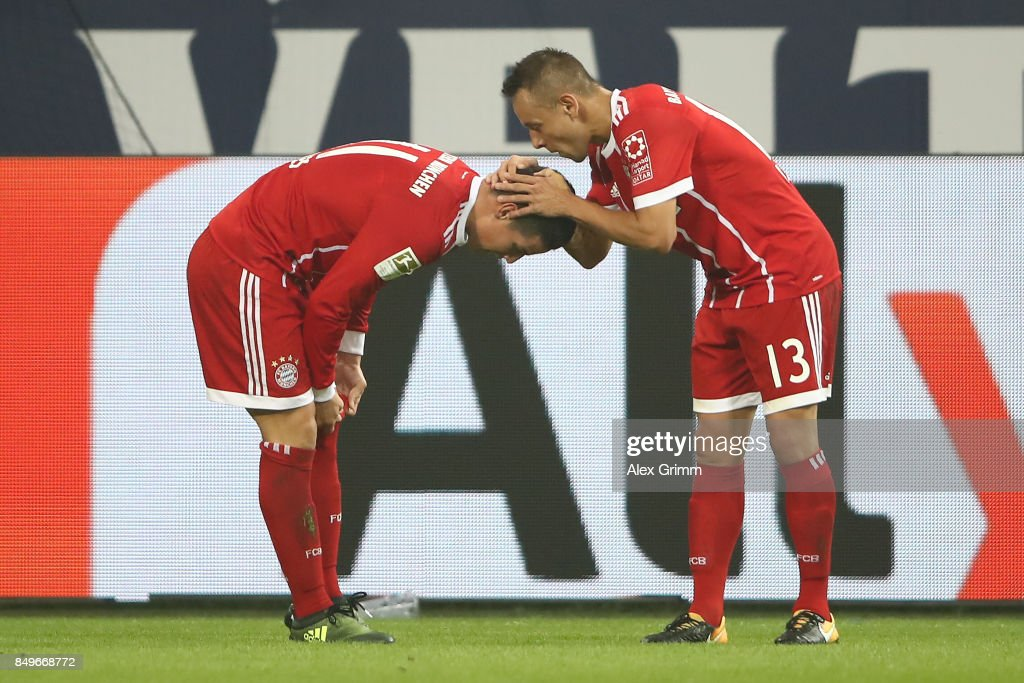 James Rodriguez of Bayern Muenchen celebrates with Rafinha of Bayern Muenchen after he scored his teams second goal to make it 2:0 during the Bundesliga match between FC Schalke 04 and FC Bayern Muenchen at Veltins-Arena on September 19, 2017 in Gelsenkirchen, Germany.