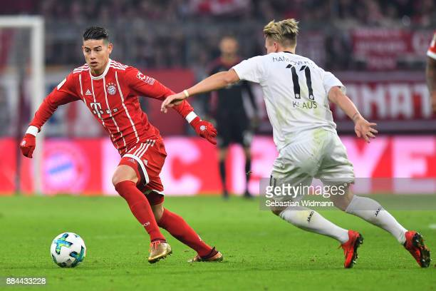 James Rodriguez of Bayern Muenchen is chased by Felix Klaus of Hannover during the Bundesliga match between FC Bayern Muenchen and Hannover 96 at...
