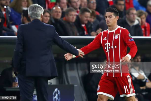 James Rodriguez of Bayern Muenchen shake hands with his head coach Carlo Ancelotti during the UEFA Champions League group B match between FC Bayern...