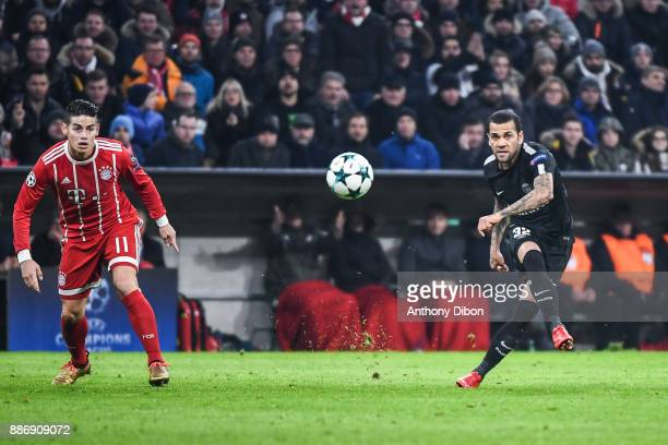 James Rodriguez of Bayern Munich and Daniel Alves of PSG during the UEFA Champions League match between Bayern Munich and Paris Saint Germain at...