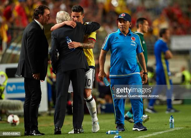 James Rodriguez of Colombia and Colombia manager Jose Pekerman embrace during the international friendly match between Spain and Colombia at Nueva...