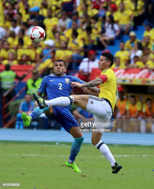 James Rodriguez of Colombia and Dani Alves of Brazil compete for the ball during a match between Colombia and Brazil as part of FIFA 2018 World Cup...