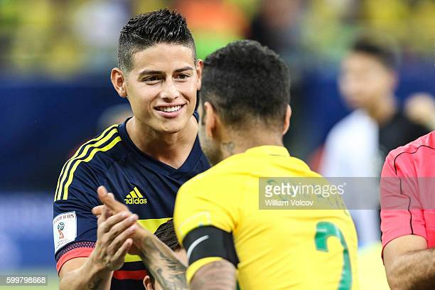 James Rodriguez of Colombia and Dani Alves of Brazil greet before a match between Brazil and Colombia as part of FIFA 2018 World Cup Qualifiers at...
