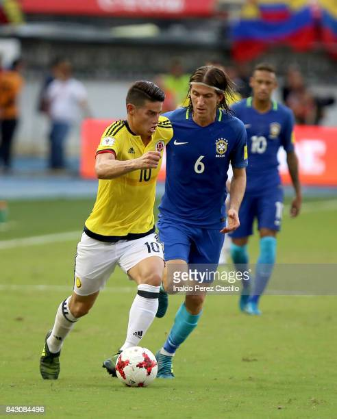 James Rodriguez of Colombia and Filipe Luis of Brazil compete for the ball during a match between Colombia and Brazil as part of FIFA 2018 World Cup...
